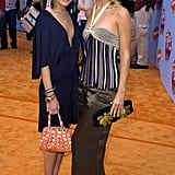 Twinning combo: For the 2004 Kids' Choice Awards, Mary-Kate and Ashley beat the Spring blues in navy-based styles.  Mary-Kate looked effortlessly radiant in a plunging navy dress, jeweled sandals, and a printed orange minibag. Ashley paired a striped navy halter with earthy silk trousers and gold metallic sandals.