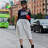 Joicy Muniz Wore a Tommy Hilfiger Navy Sweater With a White Skirt and Platform Booties