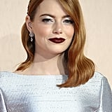 Emma Stone at the UK Film Premiere of The Favourite in Silver Eye Shadow