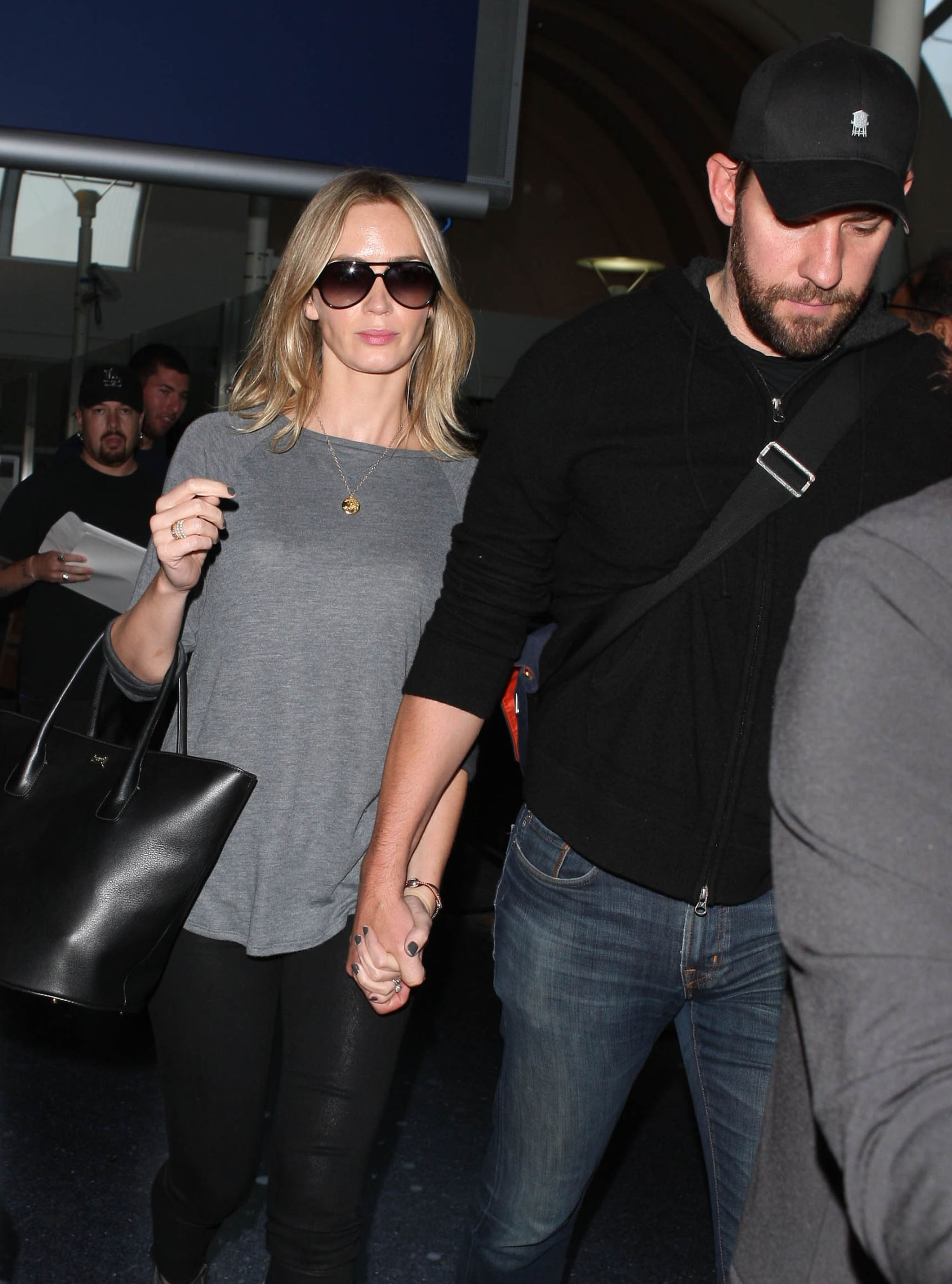 John Krasinski and Emily Blunt arrived at LAX holding hands.
