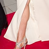 The Duchess of Cambridge flashed a little leg and a metallic Jimmy Choo heel completed her look.