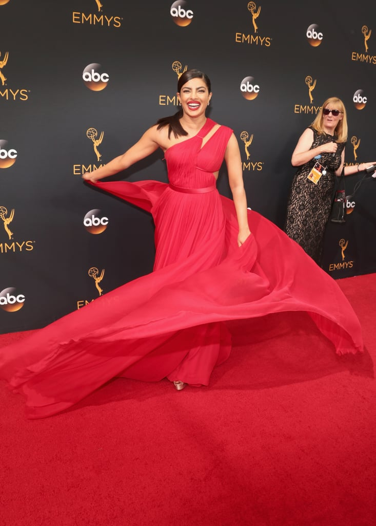 When we heard Priyanka Chopra was going to the Emmy Awards, we knew she would do it big for the red carpet. The actress glowed in a red, one-shoulder gown with an empire waist that flowed away from her silhouette. The lightweight material even flapped perfectly in the wind when Priyanka gave a twirl on the red carpet. With a look this good, we'd be dancing in it too.