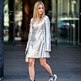 This is how you make a metallic dress work for day — just add sneakers.