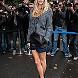 Clad in navy-blue Chanel tweed and the coolest burgundy-hued wide-brimmed fedora, Poppy Delevingne brought her recognizable cool style to the Chanel show.