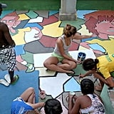 A group gathered to paint a World Cup mural on the street in Rio de Janeiro.