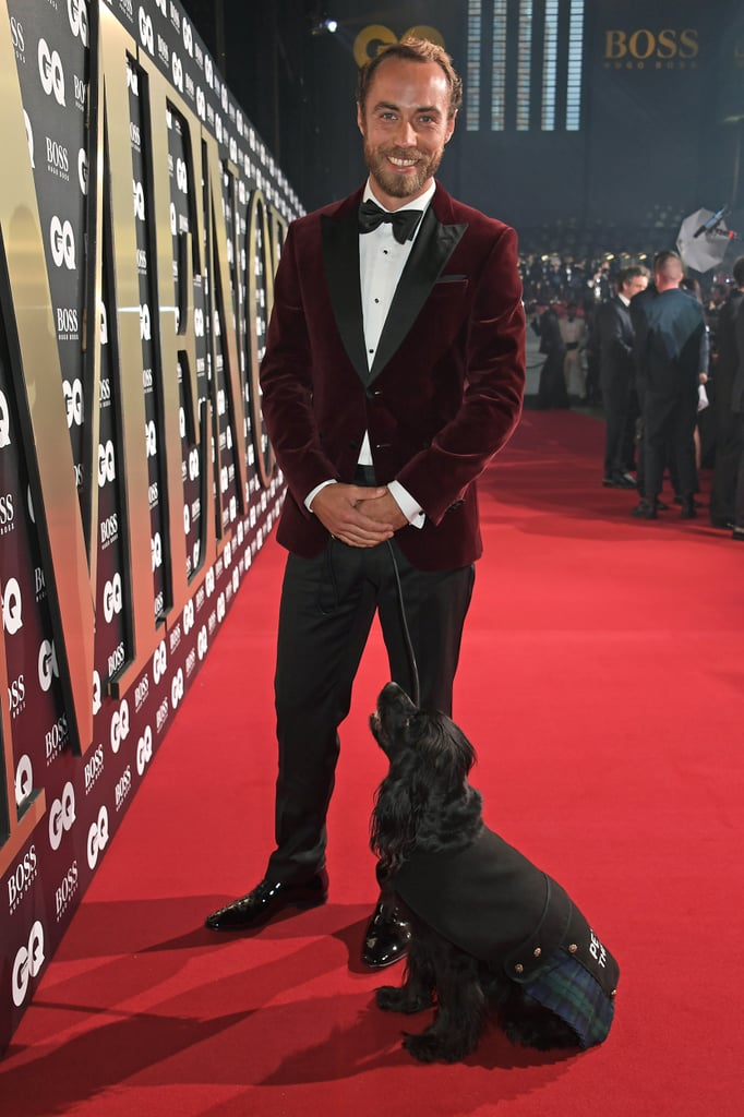 "James Middleton arguably had the best date at the GQ Men of the Year Awards in London on Tuesday. Dressed in a burgundy velvet jacket and black bow tie, Kate and Pippa's 32-year-old brother was accompanied by his furry Cocker Spaniel, Ella. The adorable duo posed for pictures on the red carpet together, but it was ultimately Ella who stole the show as she represented UK's Pets as Therapy charity in her tartan kilt. ""I think I should win the award for the best date for the GQ men of the year awards,"" James captioned an Instagram album of him and Ella at the ceremony. If you follow James on Instagram, you know that he's a huge dog lover. In addition to Ella, James has four other dogs named Inca, Luna, Zulu, and Mabel. ""Animals can provide a sense of calm, comfort, or safety and divert attention away from a stressful situation and toward one that provides pleasure,"" James wrote on Instagram in December 2018. ""I am a huge believer in this and Ella has done so much for me."" See photos from James and Ella's cute night out ahead!      Related:                                                                                                           We Love Kate and Pippa, but It's Time to Talk About Their HOT Brother, James Middleton"