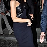 Spotted at the Dublin afterparty: Kate transformed from a vision in hot-pink Donna Karan to a sexy leather-infused halter dress vixen.