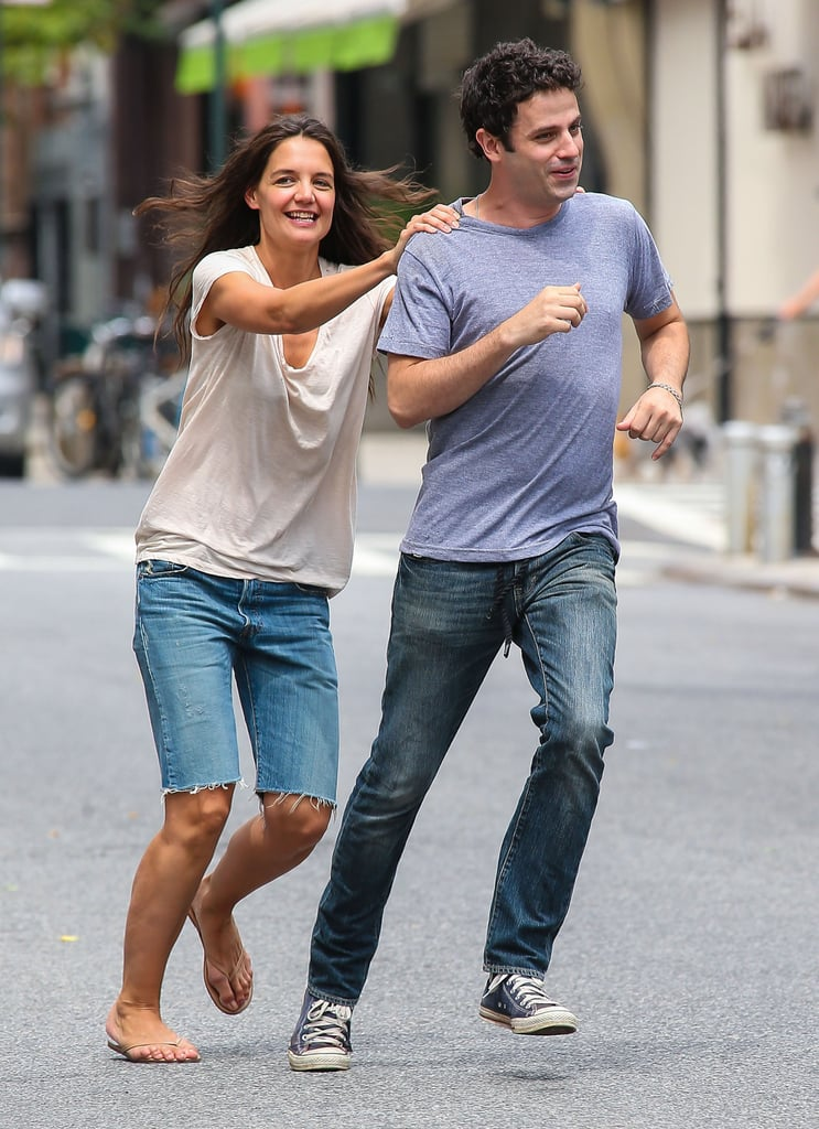 Katie Holmes chased around her Mania Days costar Luke Kirby while filming a scene in NYC yesterday. On Tuesday, the pair braved the sweltering heat to shoot on the street, including a scene which involved Katie supplying Luke with pills from a prescription bottle. The scene isn't that strange as the movie centers on the story of two manic-depressive patients who fall in love after meeting in a psychiatric ward. Katie's been balancing her time between work and spending her Summer days with her daughter, Suri Cruise. The mother-daughter duo have been hitting the pavement around the Big Apple for activities together, and last week, Katie and Suri made a hand-in-hand stop at Chelsea Piers for a playdate.