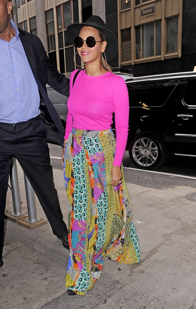 Beyoncé Knowles headed into an office building in NYC this afternoon. She was decked out in a neon pink top and printed skirt, much like the bright floral Stella McCartney pants she wore last week. Beyoncé didn't have her daughter, Blue, with her for the latest outing, though the almost 3-month-old did come along for a walk on Tuesday. Blue was bundled up in a fur sling on her mom's chest. Beyoncé's been on the go since announcing plans for her first postbaby performances over Memorial Day weekend. She also stepped out at a fundraiser for President Obama and shared a date night with husband Jay-Z.