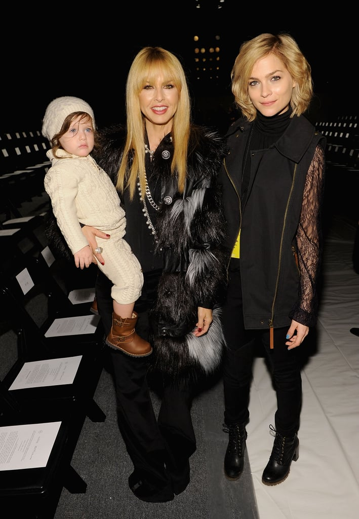 Rachel Zoe and Leigh Lezark donned two different, but equally stunning coats, at Rachel's Fall 2013 show.