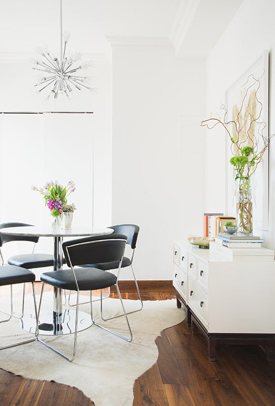 Lo's dining room seating area was completed with the addition of four Delancy side chairs from AllModern.
