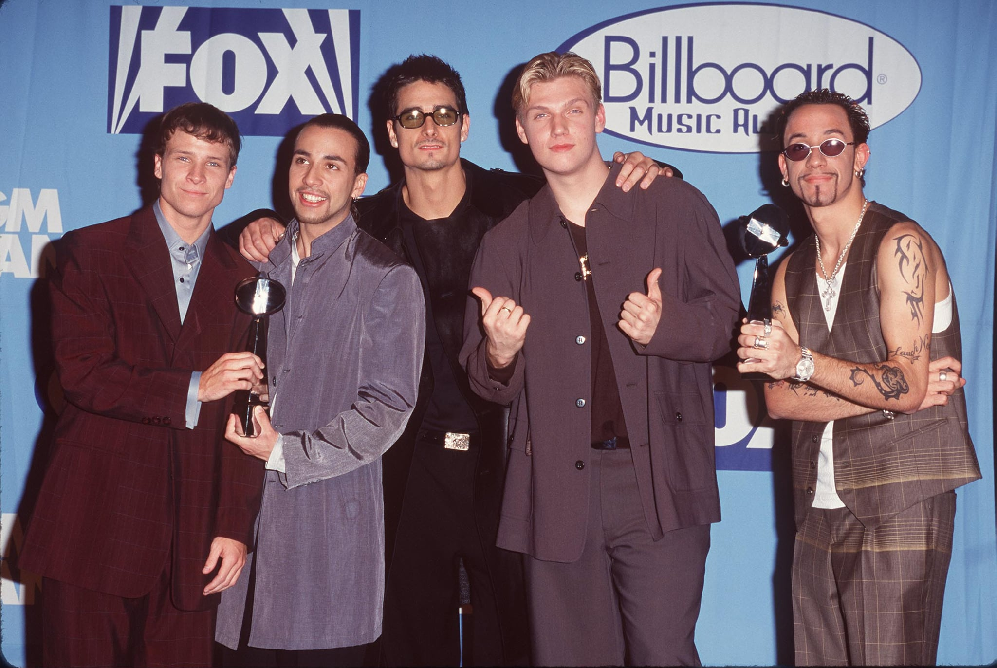 The Backstreet Boys were the center of attention backstage at the December 1998 show.