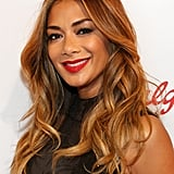 Warm golden waves and a classic centre parting gave Nicole a glam, modern look at a Red Nose Day event in May 2015, while her lipstick matched the occasion.