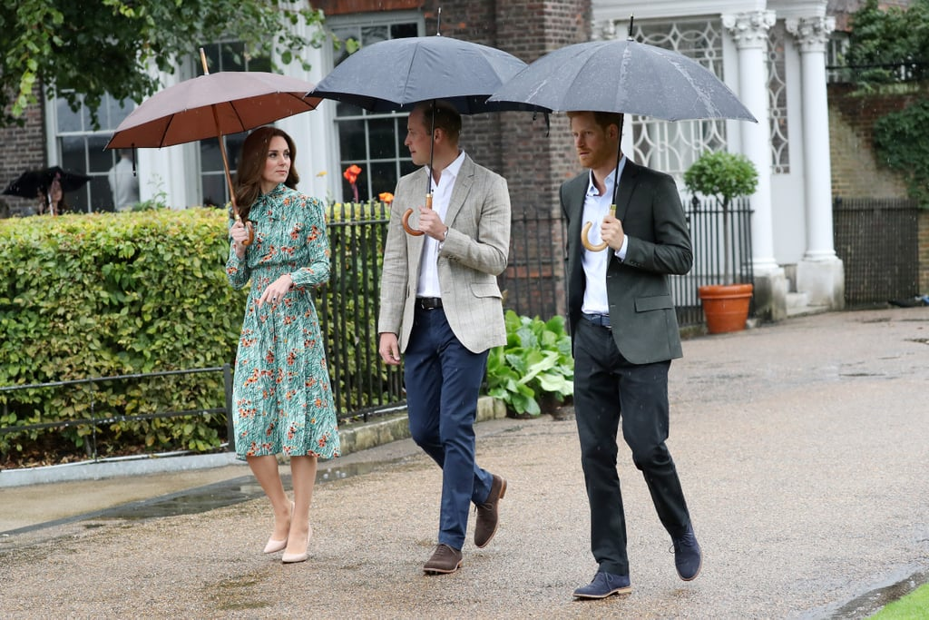 """Prince William and Prince Harry spent the eve of the 20th anniversary of their mother Princess Diana's death by paying tribute to her at Kensington Palace. On Tuesday, the royal brothers, along with Kate Middleton, visited a sunken garden on the grounds that has been transformed into a white garden in her memory. While William and Harry wore similar slacks and blazers, Kate donned a floral dress for the occasion.  Despite the rain, the trio made their way outside to greet representatives from several causes that Diana supported to honor """"the significant achievements of the Princess, and the legacy of her work which continues to resonate with so many today."""" Among the display of seasonal flowers were white lilies, which were one of Diana's favorites. """"We hope that our garden captures the energy and spirit that made her such a popular figure around the world,"""" head gardener Sean Harkin said in April."""