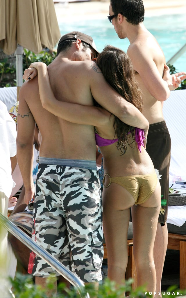 She unwound with a kiss from Cash during a holiday trip to South Beach in January 2007.