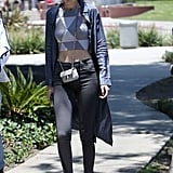 To steal Gigi Hadid's style, all you need is a geometric crop top, skinny jeans, and sneakers.