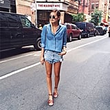 Working a Canadian tuxedo with your cutoffs is one thing. Adding round sunglasses and neutral leather sandals gives off a subtle '60s vibe that will totally elevate your look. Source: Instagram user weworewhat