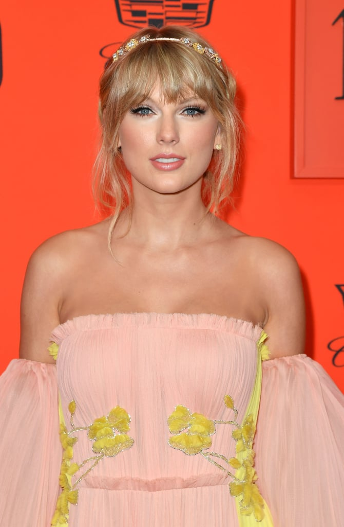 "Taylor Swift is ready to show off her mystical new era on the red carpet. On April 23, the 29-year-old singer stepped out for the Time 100 gala in NYC dressed like a princess, after making the magazine's list for a third time. Her whole look perfectly fit the aesthetic she's been teasing on Instagram for weeks, which once again begs the question: What's going on, Taylor?!  Theories have been floating around social media since Taylor set a mysterious countdown on her accounts and website for April 26. Swifties are hard at work decoding what each one of Taylor's posts means (like . . . a chicken in sunglasses?), but it's still unclear whether the palm trees, butterflies, and rainbows signify a new album, single, music video, or none of the above. Whatever it is, you can bet fans are ""ready for it."" Sorry, I had to.       Related:                                                                                                           Gigi Hadid Celebrated Her 24th Birthday With Taylor Swift, Ashley Graham, and More Celeb BFFs"