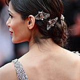 Freida Pinto let two jeweled insects add some drama to her updo at the Cannes Film Festival.