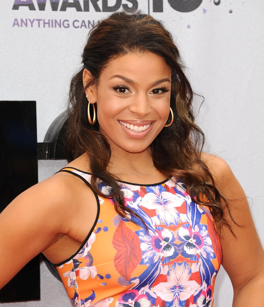Jordin Sparks wore her curly hair blown out into beachy waves and then pulled it back into a breezy half-up hairstyle.
