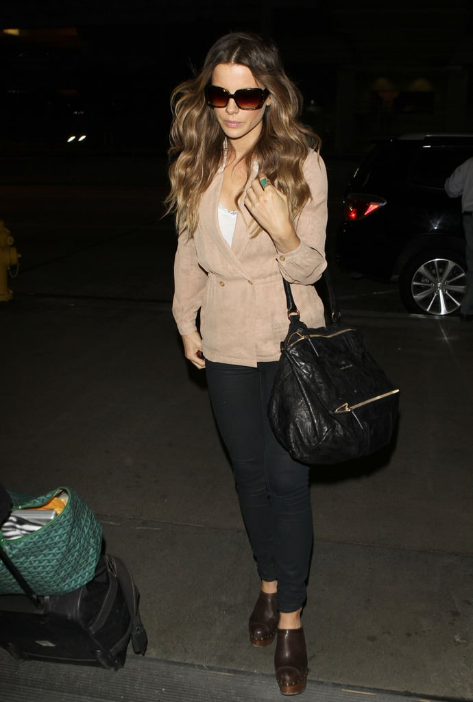 In May 2011, Beckinsale chose a knit wrap sweater, Chanel clogs, and her favorite Givenchy satchel for a trip to LAX.