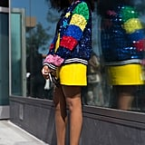 Embrace a vivid palette by pairing a colorful jacket with an even brighter miniskirt.