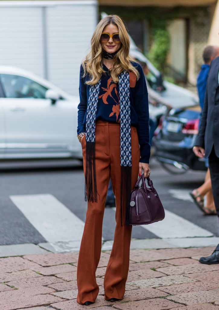 "Every season there's a new trendy shade that pops up in every It girl's wardrobe and this Fall is no different. Coined ""potter's clay,"" by Pantone, the hue contains elements of orange and brown, and is a neutral that looks great on everyone. This may be the reason why Olivia Palermo herself has been wearing the autumnal shade nonstop, incorporating it into her looks via sweaters, pants, and even belts.  Though other celebs have worn the color – and you've likely seen it all over your 'gram – Olivia's mastered this tone best of all. The rich hue not only reminds us of falling leaves, but also brings warm, fuzzy Fall memories of apple picking and pumpkin spice lattes. Read on to see how Olivia styles this potter's clay color and then incorporate it into your own clothes with our shopping picks."