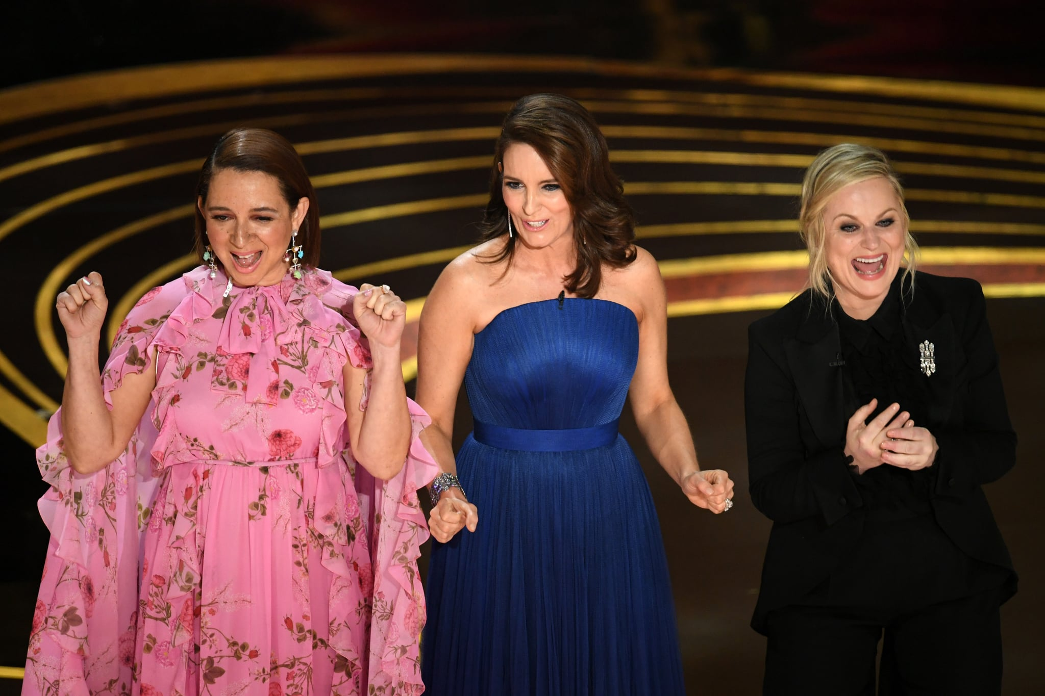 HOLLYWOOD, CALIFORNIA - FEBRUARY 24: (L-R) Maya Rudolph, Tina Fey, and Amy Poehler speak onstage during the 91st Annual Academy Awards at Dolby Theatre on February 24, 2019 in Hollywood, California. (Photo by Kevin Winter/Getty Images)