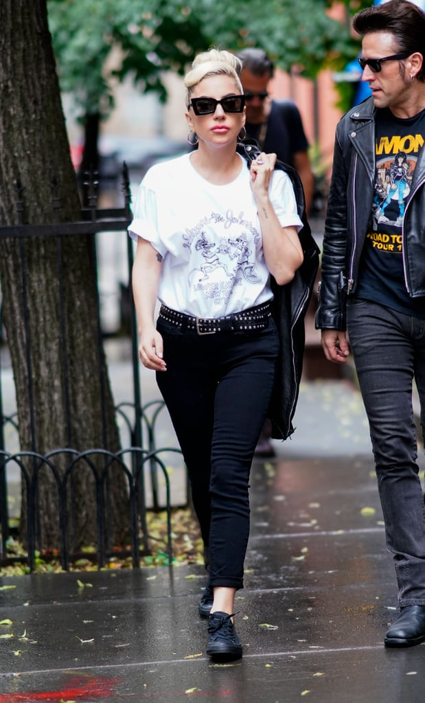 Sporting a graphic tee and black jeans.