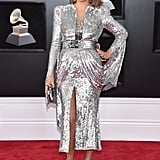 Wearing a blindingly shiny silver midi dress from Yanina Couture with matching heels and Lorraine Schwartz jewels.
