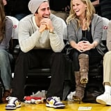 Jake Gyllenhaal and Reese Witherspoon laughed during a Lakers game in January 2009.