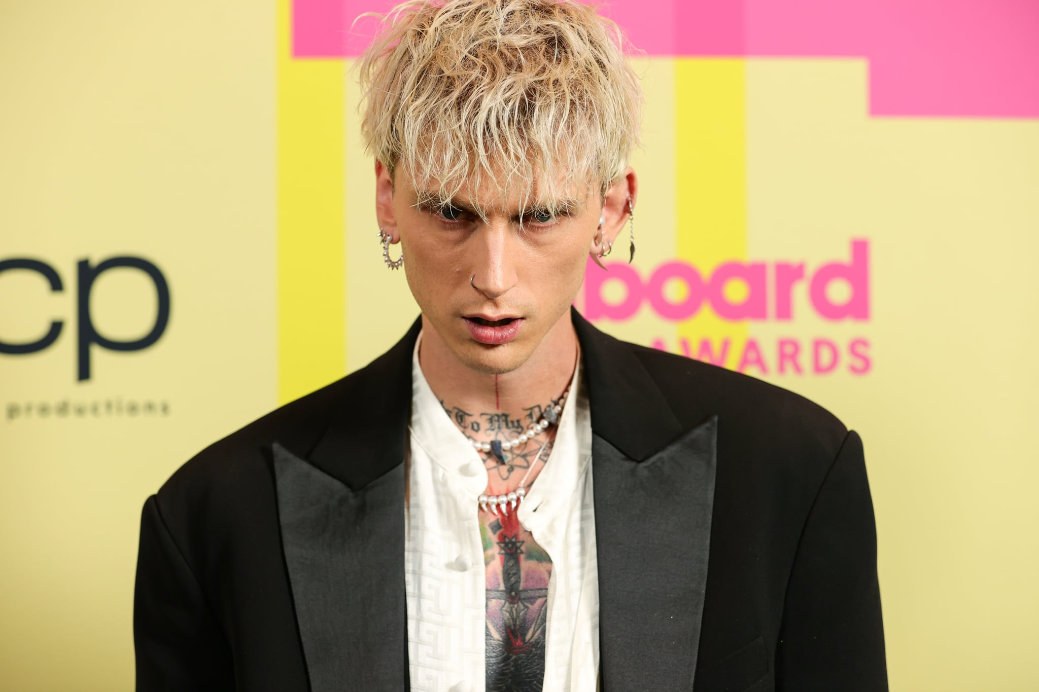 LOS ANGELES, CALIFORNIA - MAY 23: Machine Gun Kelly poses backstage for the 2021 Billboard Music Awards, broadcast on May 23, 2021 at Microsoft Theatre in Los Angeles, California. (Photo by Rich Fury/Getty Images for dcp)