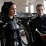 Jennifer Lawrence wore out-there costumes as Katniss Everdeen in The Hunger Games with Josh Hutcherson.  Photo courtesy Lionsgate