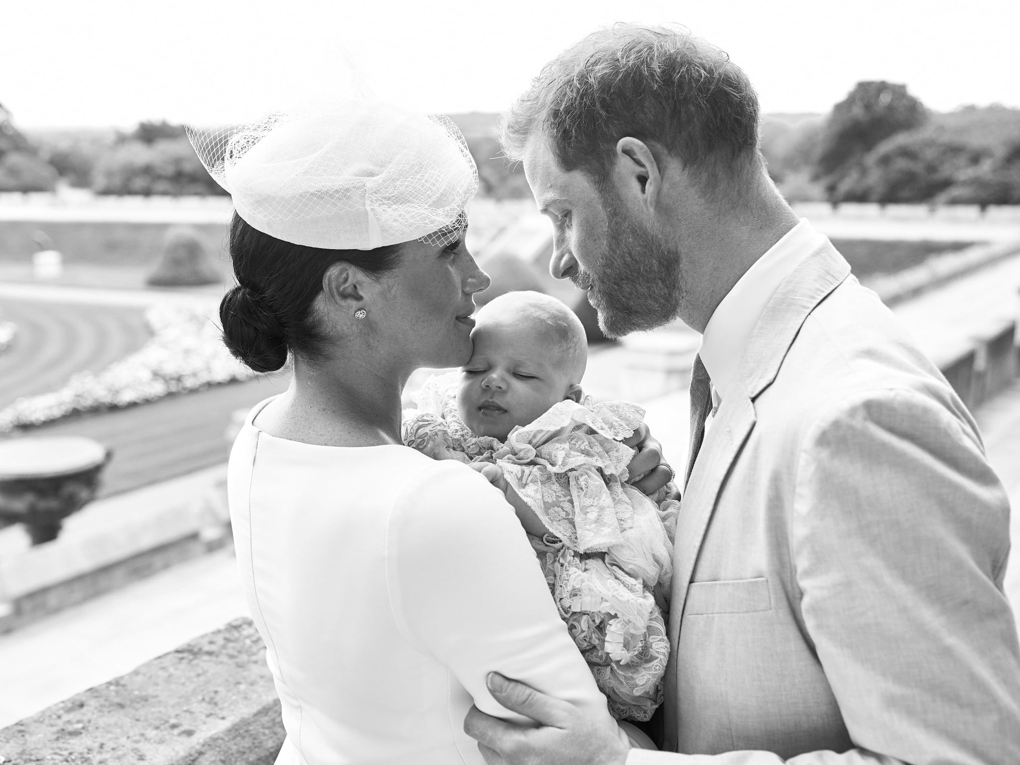 This official handout Christening photograph released by the Duke and Duchess of Sussex shows Britain's Prince Harry, Duke of Sussex (R), and his wife Meghan, Duchess of Sussex holding their baby son, Archie Harrison Mountbatten-Windsor at Windsor Castle with the Rose Garden in the background, west of London on July 6, 2019. - Prince Harry and his wife Meghan had their baby son Archie christened on Saturday at a private ceremony. (Photo by Chris ALLERTON / SUSSEXROYAL / AFP) / XGTY / RESTRICTED TO EDITORIAL USE - MANDATORY CREDIT