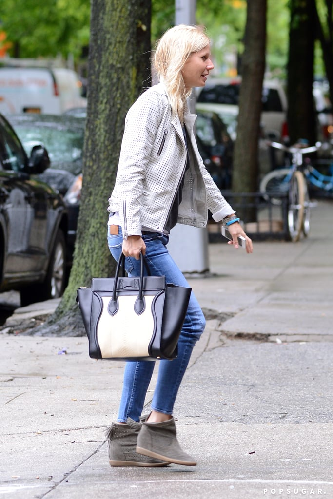 "Gwyneth Paltrow carried a Céline bag and sported Isabel Marant sneakers and a white IRO leather jacket yesterday when she stepped out in NYC. It's been a whirlwind week so far for the star, who kicked things off at the Met Gala on Monday. Gwyneth wore a pink Valentino gown for the annual fashion event, which she attended with her husband, Chris Martin. On Tuesday, Gwyneth was back in the spotlight for a visit to the SoHo Apple store, where she and her pal Jessica Seinfeld participated in an hour-long Q&A about the new Goop City Guides app. Gwyneth revealed that her daily routine includes writing and researching for Goop while her children, Apple and Moses, are at school. She practiced what she preaches yesterday, wearing an Up by Jawbone wristband after it was featured in Goop last month.  During the chat, Gwyneth also joked that the highlight of her Met Gala night was ""going home and taking my shoes off"" and spoke about her love for public transportation. Gwyneth said she ""rides the subway in London all the time"" but that ""the last time I rode the subway in New York was a year-and-a-half ago."""