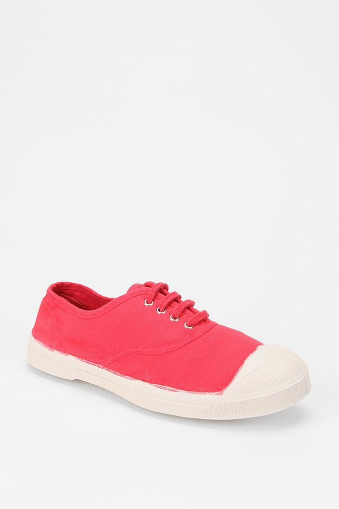 "You'll be on your feet most of the weekend so come prepared with a pair of comfortable sneakers. Bensimon is a no-fail option and who can say ""no"" to a bold red kick? Bensimon Classic Tennis Sneaker ($55)"
