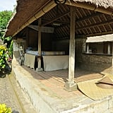 Here is a photo of a traditional Balinese house from our cultural tour. The homes were all open like this, and you'd walk from room to room. Currently, some people still live in homes like this, while others have more modern homes.