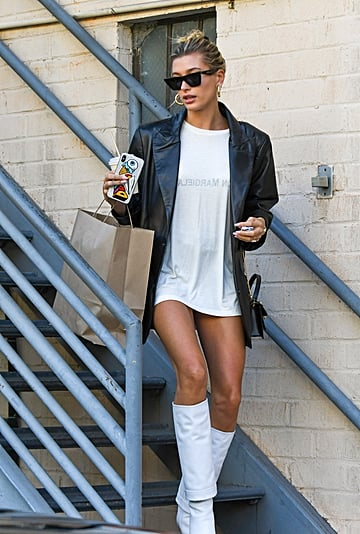 Hailey Baldwin Wearing White Boots With T-Shirt as a Dress