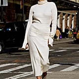 You know the ins and outs of styling monochrome outfits, so try an all-white version. To re-create this look, grab your favorite turtleneck and wear it with a matching midi skirt. Instead of heels, go with a cool printed shoe like this fashion influencer did. This effortless outfit can be done in several different ways, which we love.