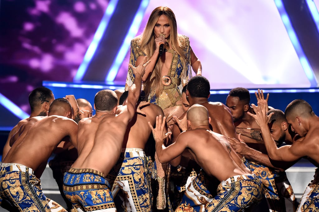 "When MTV announced Jennifer Lopez was receiving the Vanguard Award, I literally squealed! She's making history as the first Latinx artist to ever receive the award. Since blessing the world with her music in 1999, Lopez has been releasing hit after hit. Just like her fabulous music videos, Lopez's performance at the 2018 MTV VMAs is one that will stay engraved in our minds for years to come.  The 49-year-old jack of all trades gave fans exactly what we wanted by performing a medley of her greatest hits like ""Waiting For Tonight,"" ""Dance Again,"" ""Ain't Your Mama,"" ""El Anillo,"" ""Booty,"" ""Love Don't Cost a Thing,"" ""Get Right,"" and ""All I Have."" That was all before DJ Khaled stepped in as a hype man during an interlude. She came back with a completely new outfit and performed ""Jenny From the Block"" and ""I'm Real"" (with help from Ja Rule!) before ending with ""Dinero.""  Watch her do her thing ahead, as well as the best moments from the performance in (insanely gorgeous) photos."