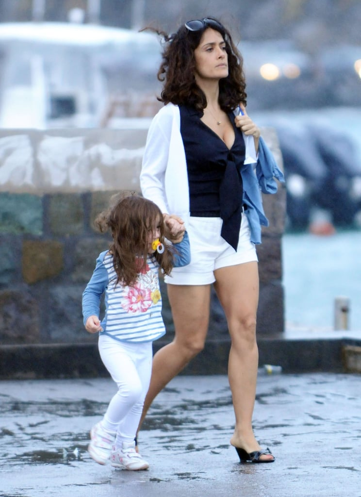 Salma Hayek boarded a boat in St. Barts yesterday with Valentina and Francois-Henri Pinault. The adorable family is on vacation together like many other famous groups following the busy holidays. Salma and Valentina both wore bikinis during a trip to the beach earlier this week, though they were a little more covered up as they headed out to explore the coast.