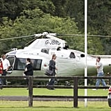 Brad Pitt steps out of a private helicopter arriving in Richmond, England.