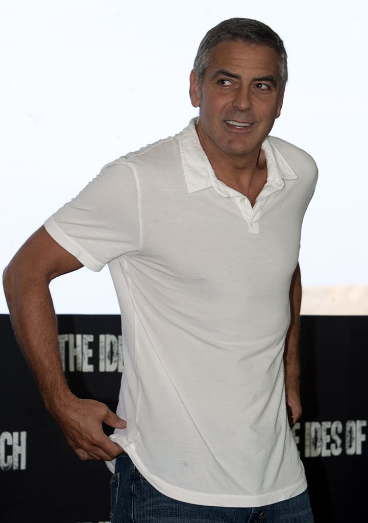 George Clooney showed off his fit form in a white polo shirt.