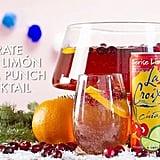 Cerise Limón LaCroix + Sparkling Grape Juice + Pomegranate Juice + Orange Slices + Cranberries