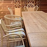 The wooden deck has plenty of seating for outdoor meals and card games.