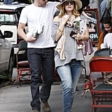 Drew Barrymore showed off her signature thrown-together chic in skinny jeans and a slouchy tee with red flats, a hippie-cool scarf, and a wide-brimmed Panama hat.