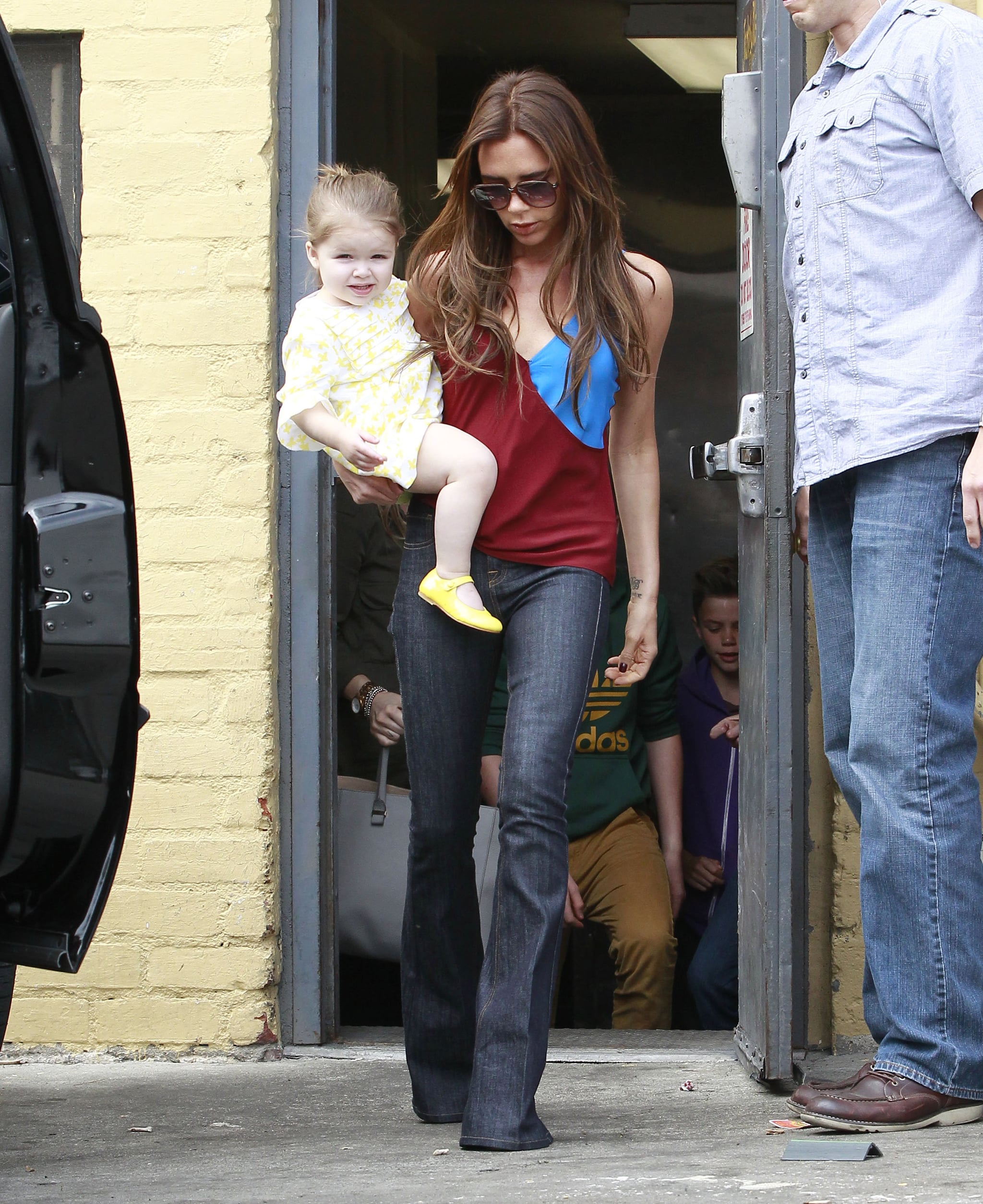 Victoria Beckham Makes a Sunny Breakfast Stop With Harper and Her Boys