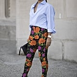 The new way to wear your blue button-down is with floral pants.
