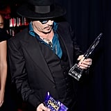 Johnny Depp checked out his award for favorite movie actor.
