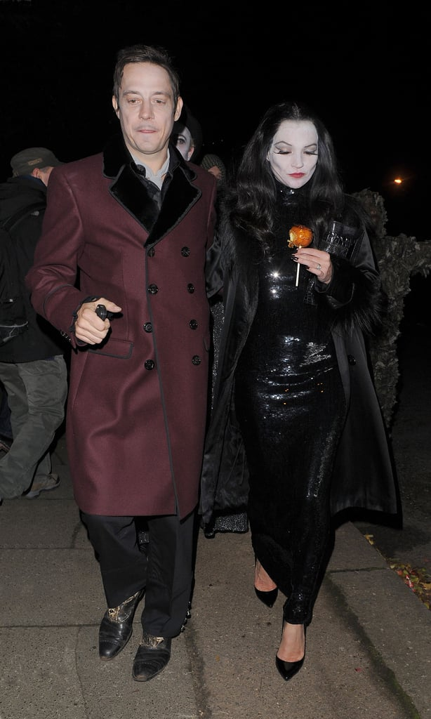 Kate Moss made her way to a costume party, decked out — face paint and all — with husband Jamie Hince.